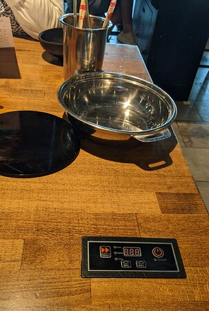 Independent hot plates to keep broth hot at Broth Shabu-Shabu.