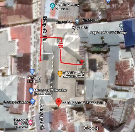 Kenyatta Rd is the main road here. You'll take the alley on the north side of the building. Small open courtyard at your first right. Go up the steps, continue until you can take a left. These stairs take you to the second floor. Once on the 2nd floor you'll take a left - go past an art/souvenir shop and a server will greet you at the entrance to the restaurant.