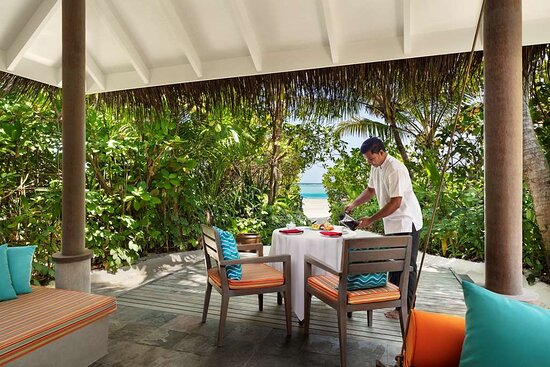 Breakfast setup on a Beach Villa balcony