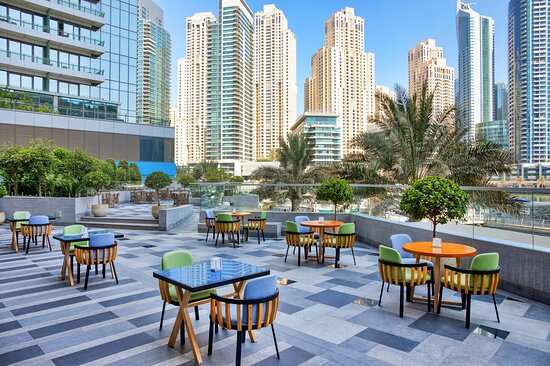 Outdoor Dining with Marina view at Lo+Cale Restaurant