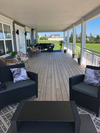 Enjoy our comfortable and spacious covered deck with views of Arichat harbour.