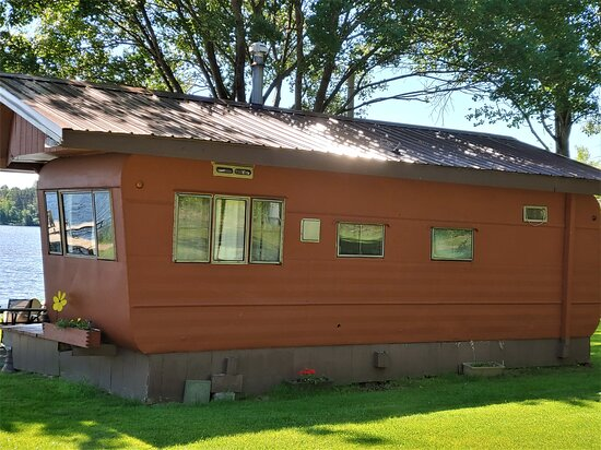 Our mobile home is situated lakeside - poured concrete patio.  Firepit in use frequently for all guest to enjoy.