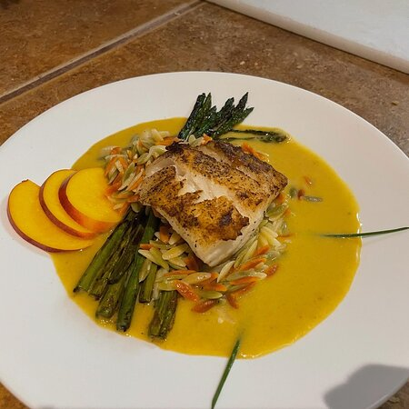 Seared Cod with a Palisade peach and coconut curry broth