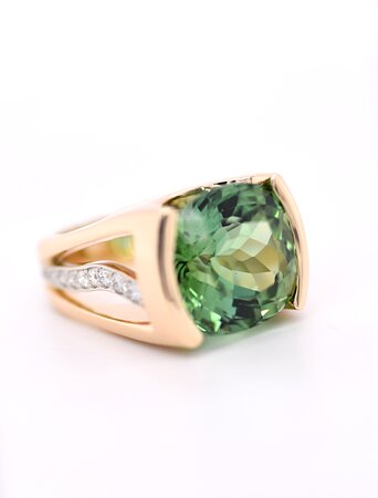 This stunning antique cushion cut green tourmaline is over 15 carats.