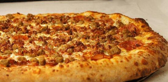 CORONARY (MEAT ATTACK)- Marinara, Ham, Italian Sausage, Pepperoni, Beef, Breakfast Bacon, topped with Mozzarella.