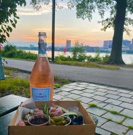 Our boxes pair well with bubbles and Boston views