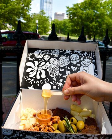 """Our """"Please Smile' artist box is designed and curated by a local artist, Henry Dunkelburger"""