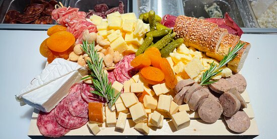 A catering board featuring some of our most popular meats, cheese and sides
