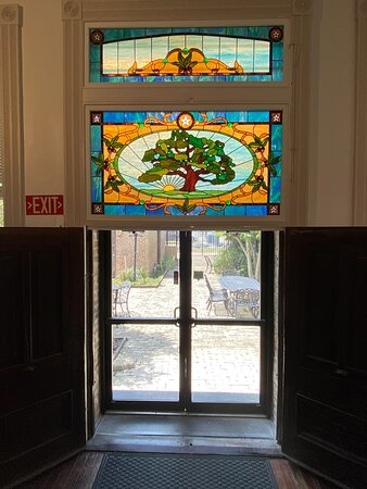 Commissioned stained glass transom honoring the beautiful oak trees of Columbus, TX
