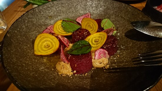 Beetroot gnocchi, mushroom custard, woody herb, beet leaf