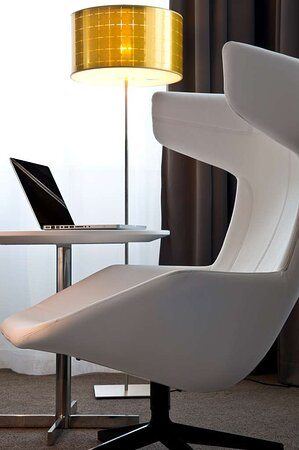 Guest Room White Chair and Laptop