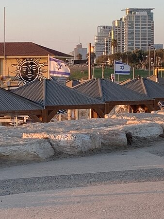 Three photos of the beach building structure with the🇮🇱
