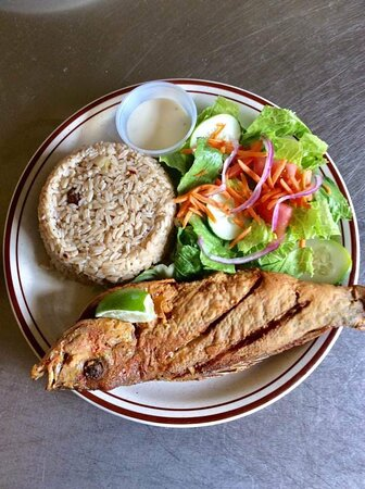 Miss B's whole fry snapper with peas and rice and salad.