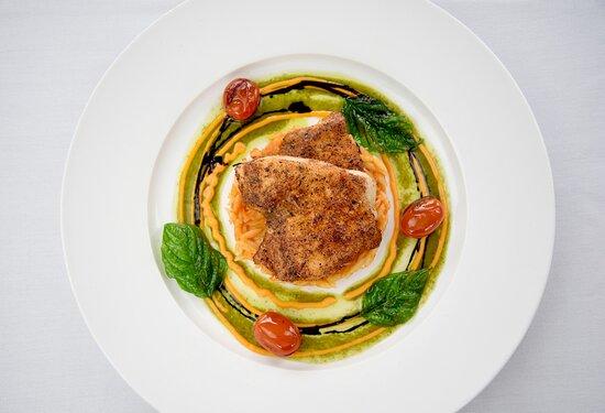 Cajan Swordfish with Orzo Pasta, Pesto Oil, Tomato-Basil Coulis, Balsamic reduction, and Aged Parmesan.