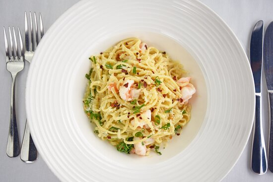 Caribbean Shrimp Linguine, Garlic Chive Sauce, Aged Parmesan, Rocket and Chilli Flakes.