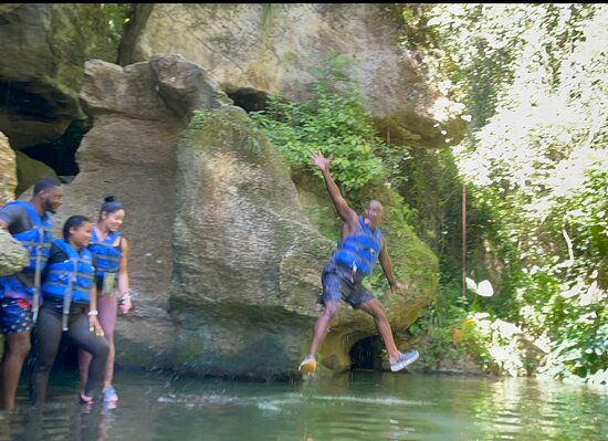 Arenales Caves and River Adventure in Puerto Rico: Mel jumping off of a rock.  Yamile took the pic.  Thanks. 