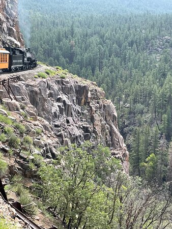 Train Travelling around one of the Several Lofty Precipices on the Route