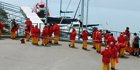 Lining up in groups of 12 people to board Zodiacs