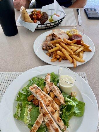 Caesar salad, jerk chicken, and a burger at The Grill