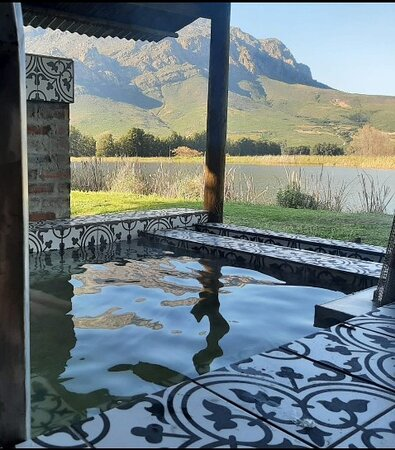 This awesome view is from a woodfire heated jacuzzi with beautiful Moroccan tiled detail at one of the log cabins.