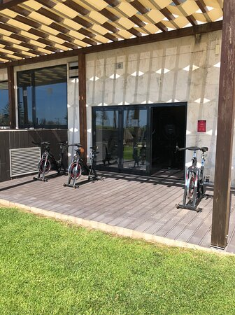 Bikes outside the small exercise room near the pool