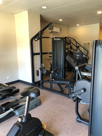 Small cramped exercise room near the pool