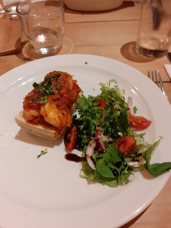 Pan Fried King Prawns, with 'Nduja and tomato sauce on garlic bread, served with a balsamic drizzled side salad - excellent