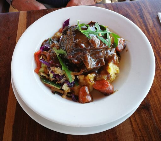 Lamb neck with caramelised onions and stir fry