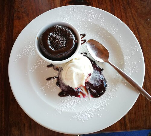 Chocolate Volcano with ice cream and berry coulis
