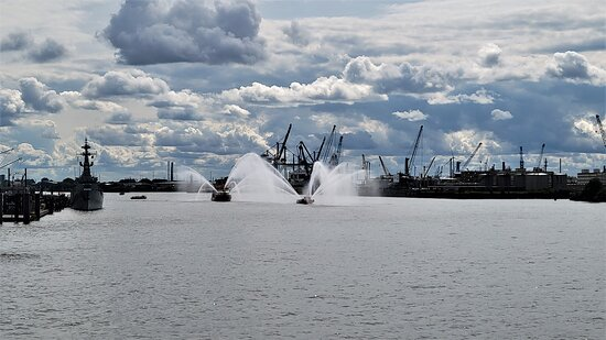 Harbor cruise on the beautiful Elbe: Fire boats doing routine practice runs