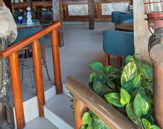 Steps up into The Blue Shrimp Restaurant.