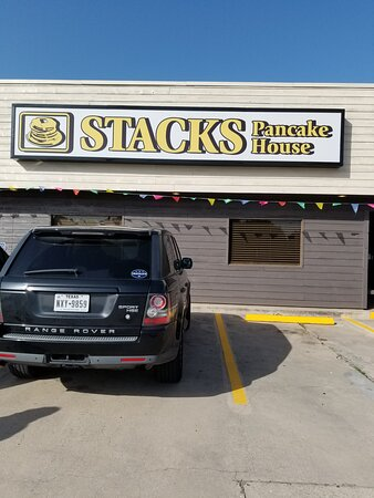 """Stacks pancake house on Dallas Drive in Denton Tx. Had breakfast with my husband and it was ok. Told the waitress my coffee was warm not hot and her reply was""""steams coming off it"""". French toast was fine and my husband had a waffle to which he said hes had better. They weren't too busy for a Sunday morn, not sure what the problem was. Hopefully it will iron out the wrinkles and become a hot spot for breakfast."""