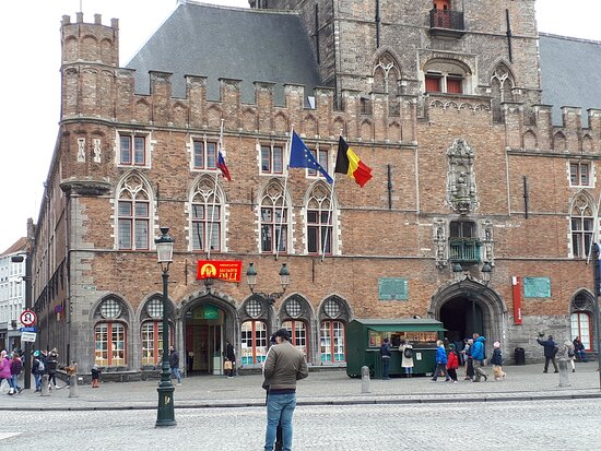 Belfry of Bruges with the entrance of the Salvador Dali exhibition.