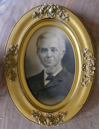 """Photograph of an early resident of northwest Missouri  from the """"As You Like It"""" room wall."""