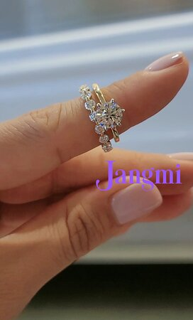 1.5ct round brilliant cut on our two tone elegant six prong solitaire. paired with love single prong love blossom.