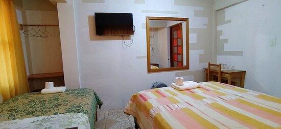 INCLUYE:  🔸 Una cama de 2 plazas + 1 cama de 1/2plaza                              🔸 Minibar con stock 🔸Baño privado con Agua caliente🚿 🔸Tv Led Smart- Cable 📺 🔸 Wi-fi en toda nuestra área.  🔸Cocina comedor Implementada 🔸 Teléfono intercomunicador (si desea alguna bebida a su habitación)📞 🔸 Espacio de lavandería