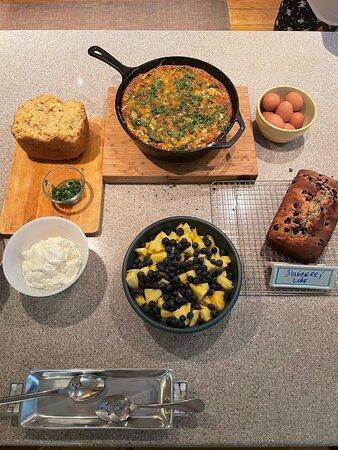 Breakfast: vegetable frittata, blueberry cake, freshly baked oat bread, Greek yogurt with fresh fruit.