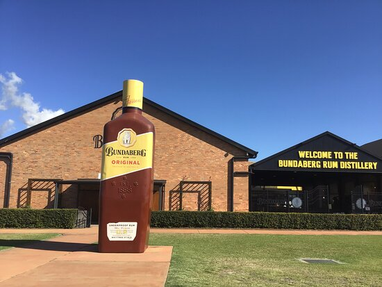 Bundaberg Rum Behind The Scenes Distillery Tour And Museum Experience: Big Rum bottle at the front of building.