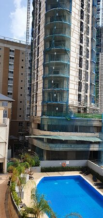 view from terrace showing major building site (3 new tower blocks) next to property - right over the pool.