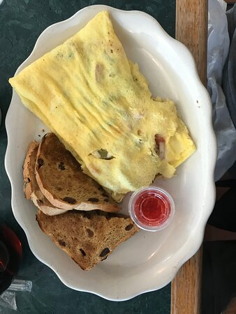 KATIE'S SPECIAL - Baked French toast, choice of meat and two eggs