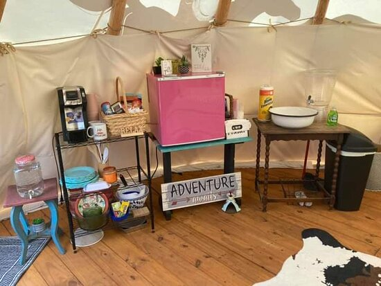 Lewisburg, TN: Kitchenette inside the tipi. Mini fridge stocked w/ bottled water, coffee pot & coffee, dishes, utensils, garbage bags, paper towels, etc.