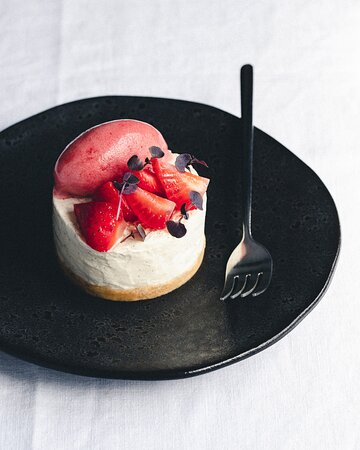 Vanilla and buttermilk cheesecake, compressed strawberry, sorbet and Thai basil