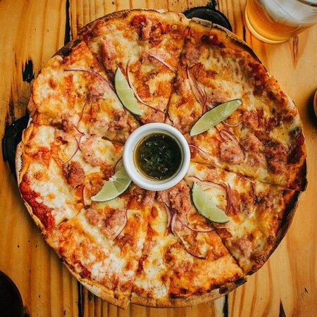 Pizza Gaucha: sausage, tomatoe, red onion, with lemon and chimichurri