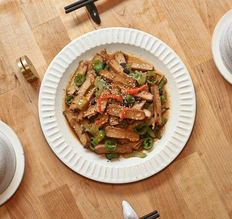 Wok-fried smoked tofu. The vegetarian dish with the unique aroma of lightly smoked tofu.