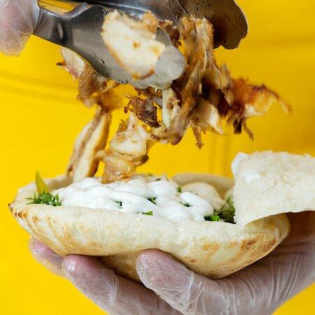 Our special Shawarma Chicken Kmaja! #alkalhaqatar #shawarmalovers #shawarmasandwich #kmajabread #chickenshawarma