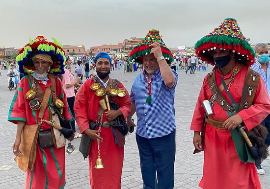 My husband with some locals in Jem El Efna square