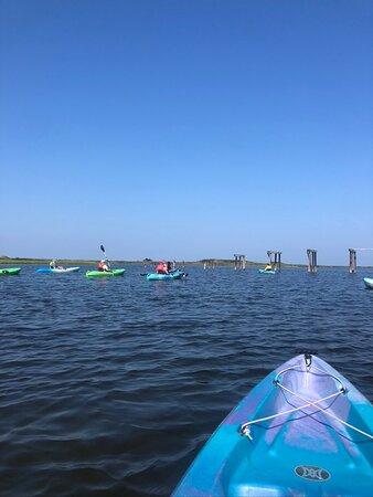 Pea Island, several kayakers, and old bridge