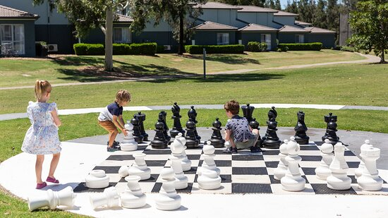 Playing giant chess on the resort's activities lawn