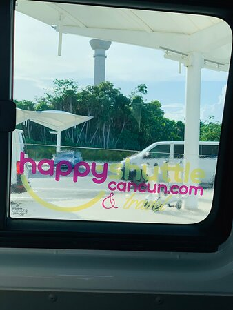 Private Roundtrip Transportation from Cancun Airport to Cancun Hotel Zone: at Cancun airport inside VW Transporter.