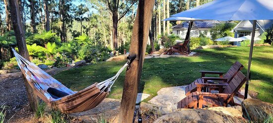A private community area exclusively for our two cottages where guests can relax, stare deep into the Dandenong forest, gently swing in one of our double hammocks, or play a casual lawn game of croquet or Finska.